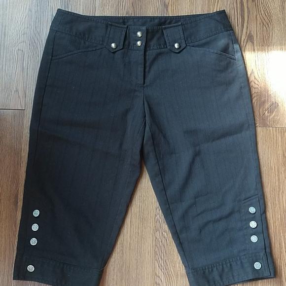 Black capri shorts with button details